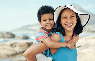 Buy stock photo Shot of a mother and son bonding while on vacation at the beach