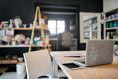 Buy stock photo Shot of a laptop on the table inside the office of a floral store