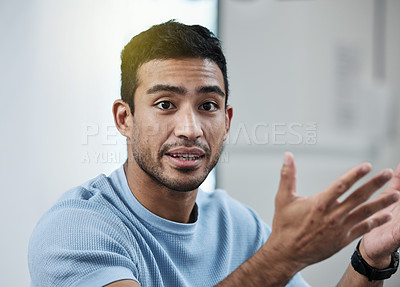 Buy stock photo Shot of a young businessman giving a presentation