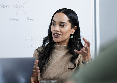 Buy stock photo Shot of a young businesswoman giving a presentation in the office