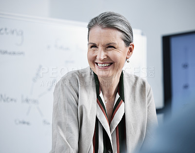 Buy stock photo Shot of a female businesswoman in her office