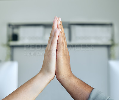Buy stock photo Cropped shot of two unrecognizable businesspeople giving each other a high five in the office