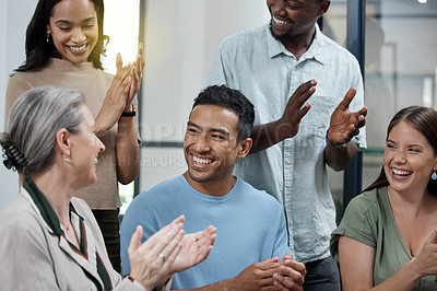 Buy stock photo Shot of a group of businesspeople applauding in an office