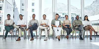 Buy stock photo Shot of a group of people waiting to be interviewed for a job at a modern office