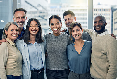 Buy stock photo Shot of a team of colleagues together in their office
