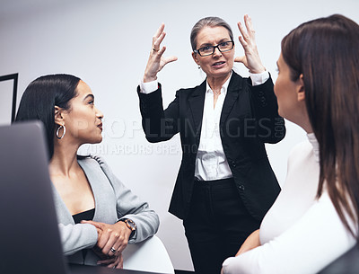 Buy stock photo Shot of a manager speaking to her staff