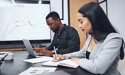 Buy stock photo Shot of work colleagues working together in their office
