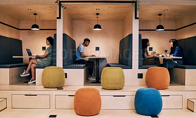 Buy stock photo Shot of creatives working in cubicles