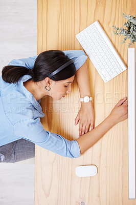 Buy stock photo Shot of an exhausted businesswoman taking a nap at her desk