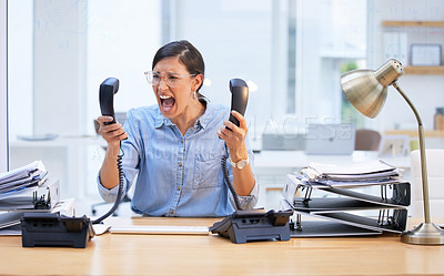 Buy stock photo Shot of a young businesswoman screaming in frustration at her telephone