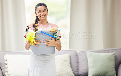 Buy stock photo Shot of a young woman holding a bucket with cleaning products  at home