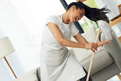 Buy stock photo Shot of a cheerful woman dancing with a mop at home