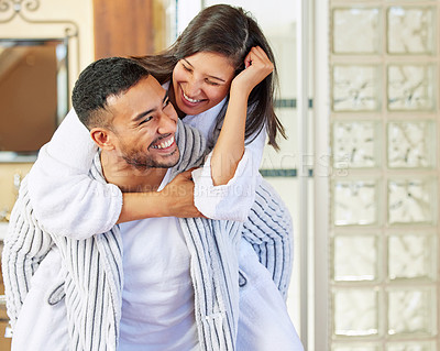 Buy stock photo Shot of a couple wearing pyjamas while spending quality time together at home