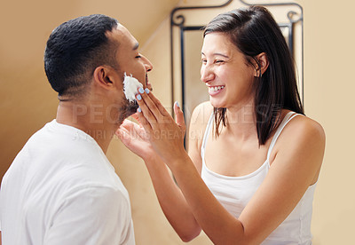 Buy stock photo Shot of a woman putting shaving cream on her boyfriend's face