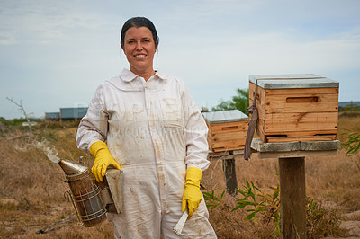 Buy stock photo Portrait of a woman wearing a beekeeping suit while working on a farm