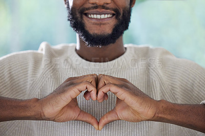 Buy stock photo Shot of an unrecognizable man making a heart shape with his hands