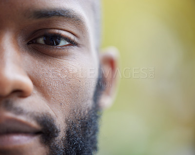 Buy stock photo Closeup shot of one side of a young man's face