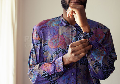 Buy stock photo Shot of an unrecognizable man buttoning a shirt at home