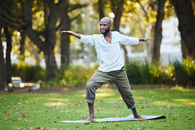 Buy stock photo Full length shot of a handsome young man practicing yoga outside in the park