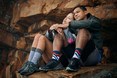 Buy stock photo Shot of a young couple admiring the view while out hiking together