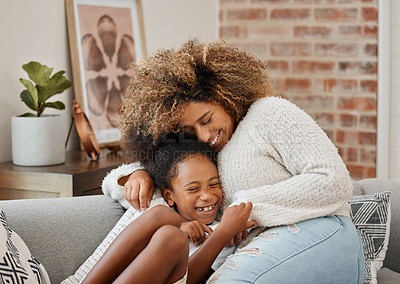 Buy stock photo Shot of a mother and daughter sitting on the couch