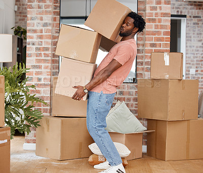 Buy stock photo Shot of a man carrying boxes into his new home