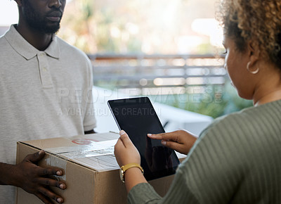 Buy stock photo Shot of a unrecognizable woman receiving a box from a deliveryman at home