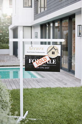 Buy stock photo Shot of for sale sign with a sold sticker outside a house