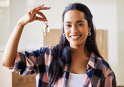 Buy stock photo Shot of a young woman showing the keys to her new home