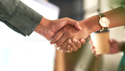 Buy stock photo Shot of two businesswoman shaking hands in greeting