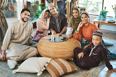 Buy stock photo Shot of a young muslim family relaxing together during ramadan