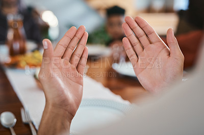 Buy stock photo Shot of a muslim person praying before breaking their fast
