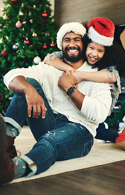 Buy stock photo Portrait of a happy young father and daughter celebrating Christmas at home