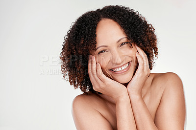 Buy stock photo Cropped portrait of a beautiful mature woman posing against a grey background in studio