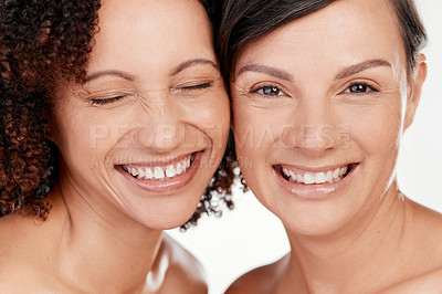 Buy stock photo Cropped shot of two beautiful mature women posing against a grey background in studio