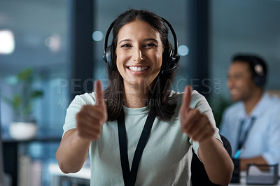 Buy stock photo Portrait of a young woman using a headset and showing thumbs up in a modern office