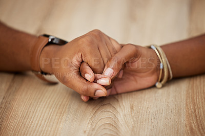 Buy stock photo Shot of two unrecognizable people holding hands at home