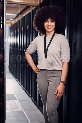 Buy stock photo Portrait of a young beautiful woman posing while working in a server room