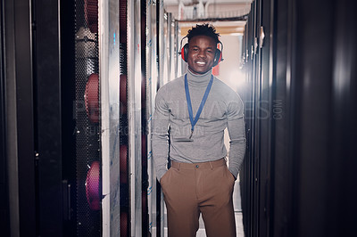 Buy stock photo Portrait of a handsome young man with hands tucked into his pockets in a server room at work