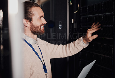 Buy stock photo Cropped shot of a young man using a laptop in a server room at work