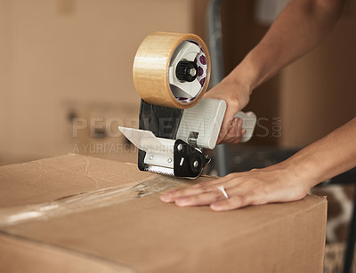 Buy stock photo Shot of a unrecognizable woman packing up to move in a room at home