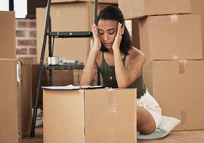 Buy stock photo Shot of a young woman having a stressful day during packing at home