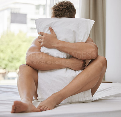 Buy stock photo Full length shot of an unrecognizable young man sitting in bed with his pillow over his head