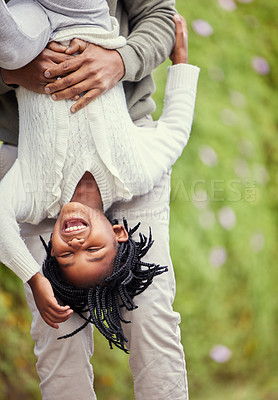 Buy stock photo Shot of a young girl playing with her father in nature