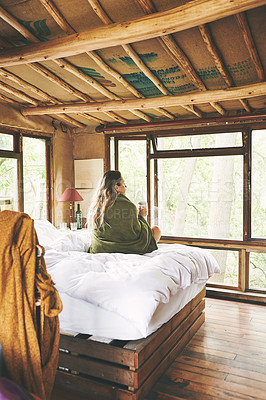Buy stock photo Rearview shot of a young woman admiring the view from her cabin window