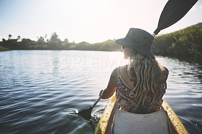 Buy stock photo Shot of a young woman out canoeing on a lake