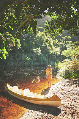 Buy stock photo Shot of a young woman out by the lake