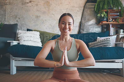Buy stock photo Portrait of a young woman meditating while practising yoga at home