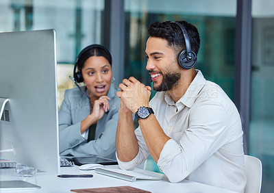 Buy stock photo Shot of two businesspeople working in a call center