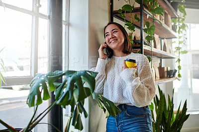 Buy stock photo Shot of a young woman talking on the phone at home